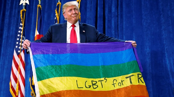 Donald Trump protecting his political career, by strutting around with the «gay» flag.